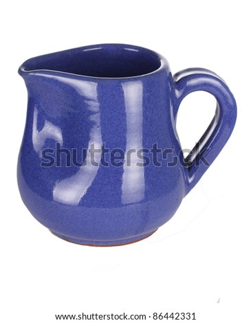 Blue Pottery Milk jug - stock photo
