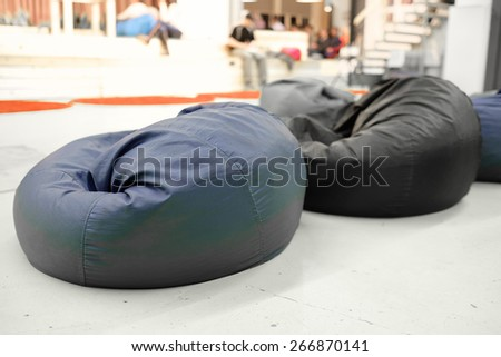 Blue pouf. Soft beanbag - stock photo