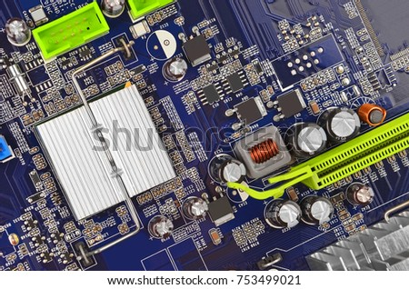 Blue printed computer motherboard with microcircuit, close-up