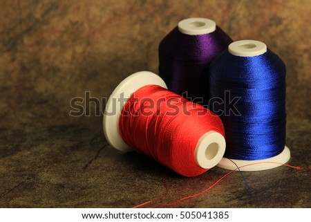 blue purple and scarlet thread