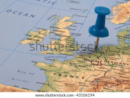 Blue push pin in a map, indicating the position of Amsterdam, The Netherlands - stock photo