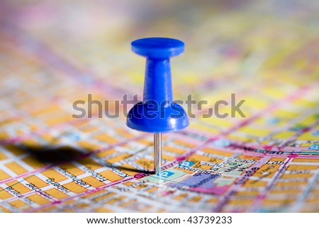 blue pushpin on the map - stock photo