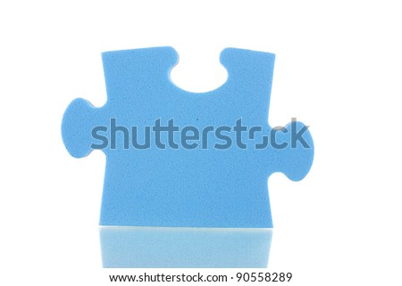 Blue puzzle closeup, isolated on white - stock photo