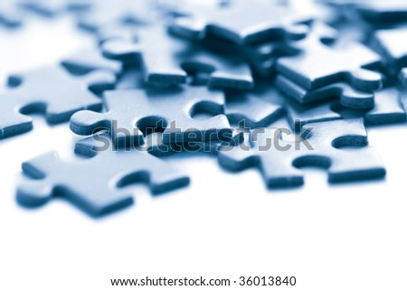 blue puzzle pieces isolated - stock photo