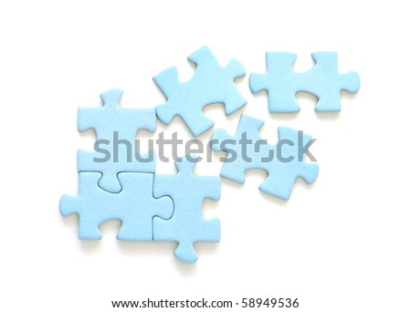 Blue puzzle pieces on white background