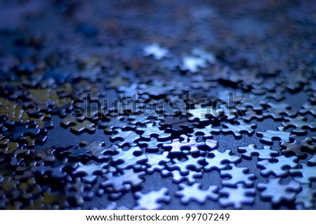 blue puzzle pieces very shallow depth of field, good background image or concept (confusion, indecision) - stock photo