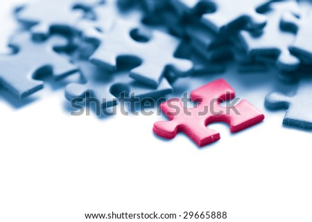 blue puzzle with one pink piece - stock photo