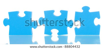Blue puzzles closeup, isolated on white - stock photo