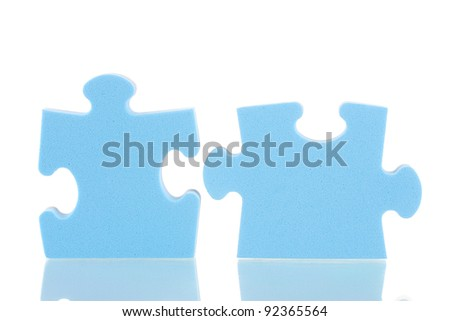 Blue puzzles closeup, isolated on white