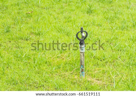 Blue pvc pipe with sprinkler water head on green fresh grass field & Blue Pvc Pipe Sprinkler Water Head Stock Photo (Royalty Free ...