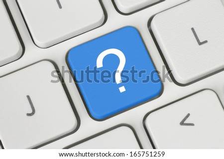 Blue question button on the keyboard   - stock photo