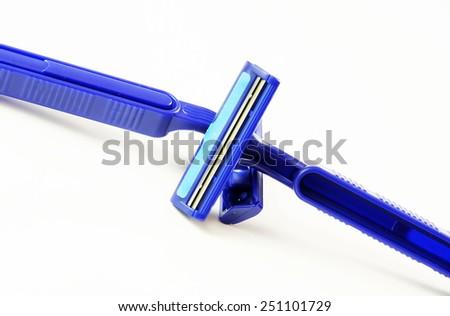 Blue razor on white background. - stock photo