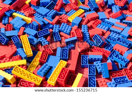 Blue, red and yellow lego toy bricks background  - stock photo