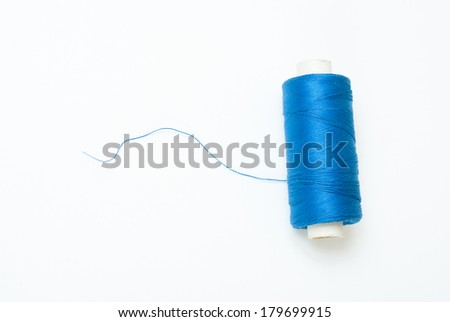 blue reel of thread on white, not isolated