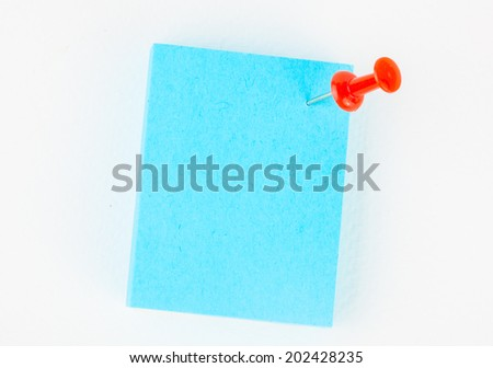 Blue reminder note with red pin on white paper background. - stock photo