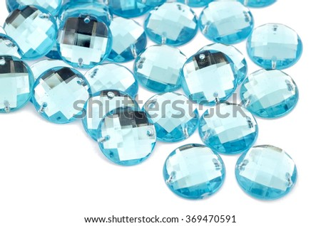 Blue rhinestone on white background