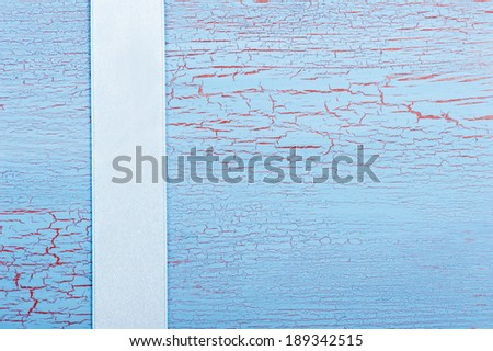 Blue ribbon on shabby blue red background - stock photo