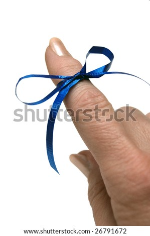 Blue ribbon tied around finger as a reminder on white background - stock photo