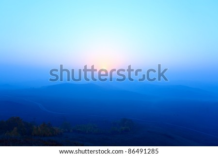 blue ridge mountains in sunrise at grassland - stock photo