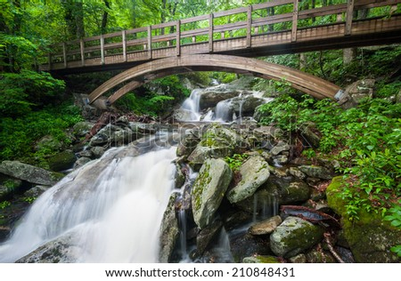 Blue Ridge Mountains Tanawha Trail Bridge Over Waterfall - stock photo