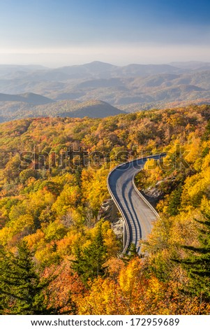 Blue ridge Parkway in Autumn with a secret vantage point of the Linn Cove Viaduct at sunrise - stock photo