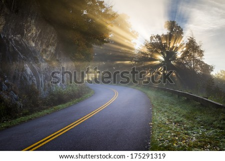 Blue Ridge Parkway North Carolina Sun Rays of Light beam through the trees along the road in the Appalachian Mountains in western NC