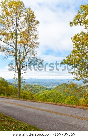 Blue Ridge Parkway road in Autumn, USA. View of valley and forest mountain.