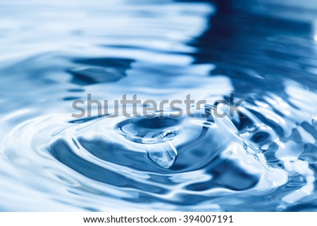 Blue rippled water detail - stock photo