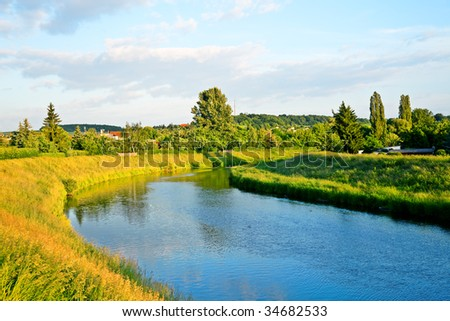 Blue river in gemeny city - stock photo