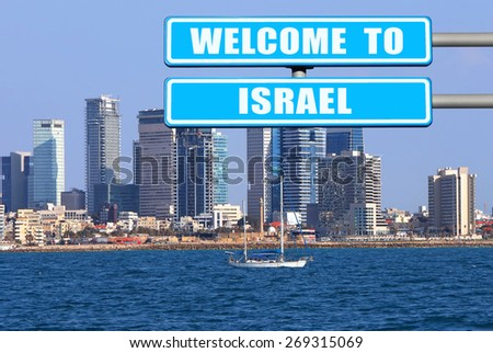 "Blue road sign "" Welcome to Israel "" - the invitation to the Israel ( visit and travel) against the Tel Aviv coast view. Mediterranean, Israel - stock photo"