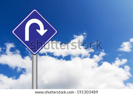 Blue road sign with U Turn traffic sign with blue sky background