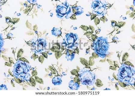 Blue Rose Fabric Background, Fragment of colorful retro tapestry textile pattern with floral ornament useful as background - stock photo