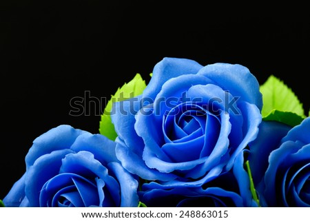 Blue rose flower on black background, made from clay - stock photo