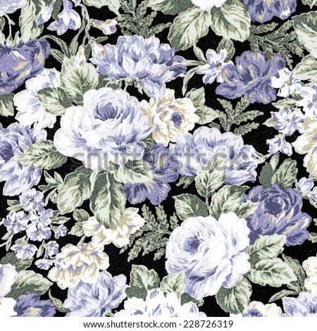 Blue Rose Vintage On Fabric Background, Fragment of colorful retro tapestry textile pattern with floral ornament useful as background. - stock photo
