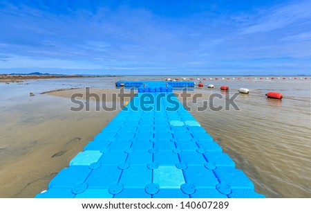 blue rotomolding of jetty against blue sky - stock photo