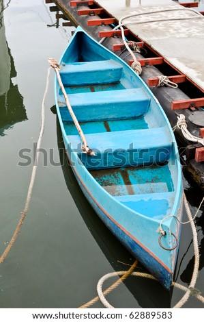 Blue rowboat - stock photo