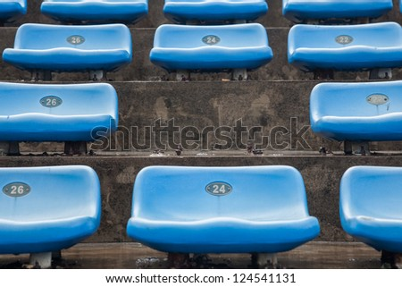 blue rubber seats in a sport stadium in the out door under rain, with wet seats