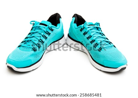blue running shoes isolated on white background - stock photo
