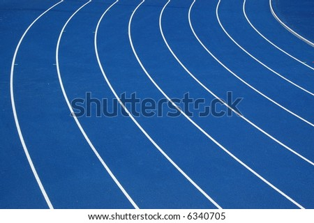 Blue running track - stock photo