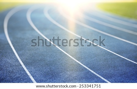 blue running track for athletics and competition - stock photo