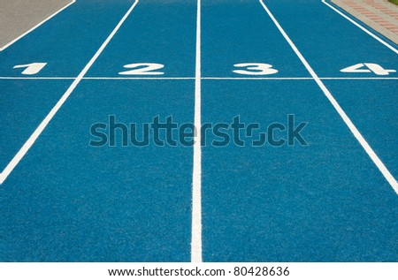 Blue running track starting line - stock photo