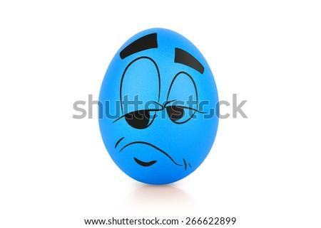 Blue sad egg with emotional face isolated - stock photo