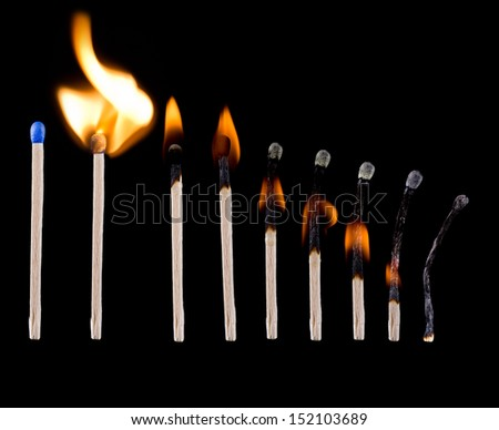 Blue safety matches over black background - stock photo