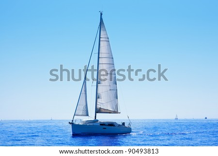 blue sailboat sailing mediterranean sea with water horizon - stock photo