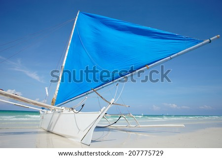 Blue sailes boats on the Boracay island beach; Philippines