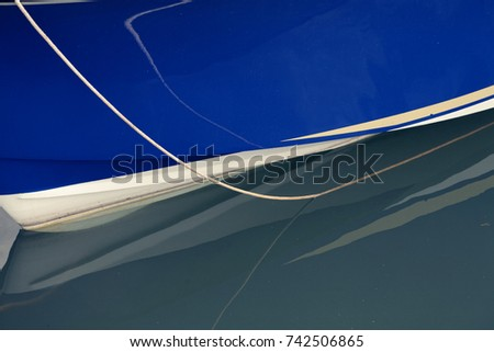 blue sailing boat body in green water