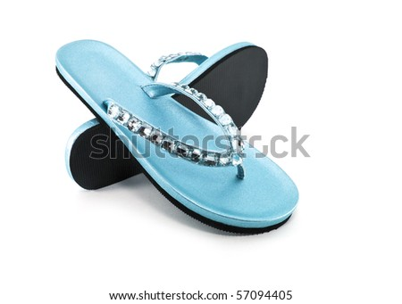 Blue sandals or flip flops with gems - stock photo