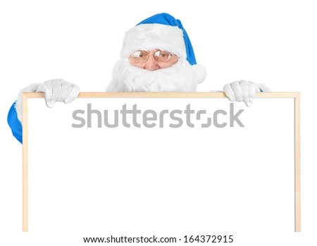 Blue Santa and empty white board over white background - stock photo