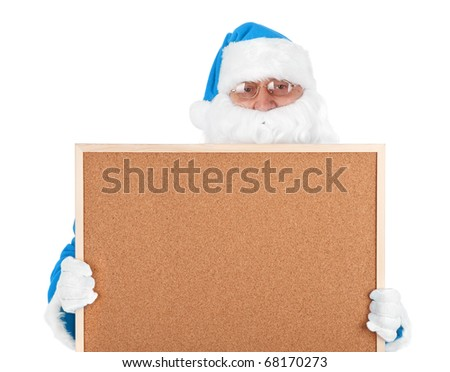 Blue santa claus and part of empty bulletin board on white background - stock photo