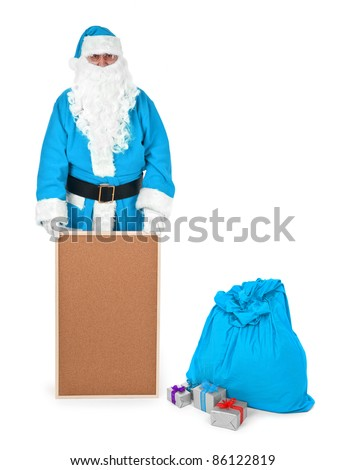 Blue santa claus shows empty bulletin board on white, minimal natural shadow in front - stock photo